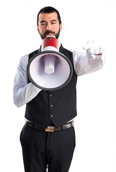 Luxury waiter shouting by megaphone
