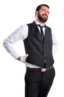 Роскошный официант с болями в спине
