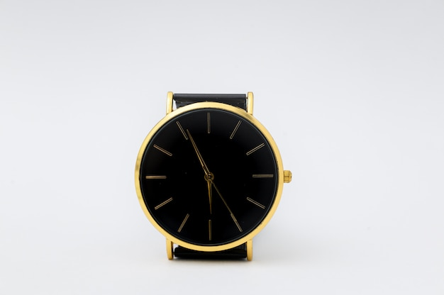 Luxury watch on white wall