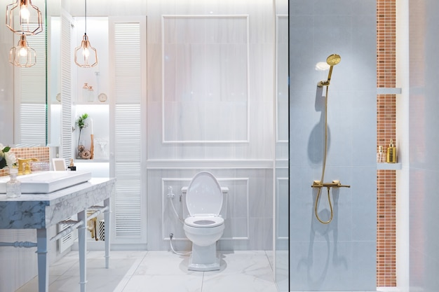 Luxury white bathroom interior in the french style in the house.