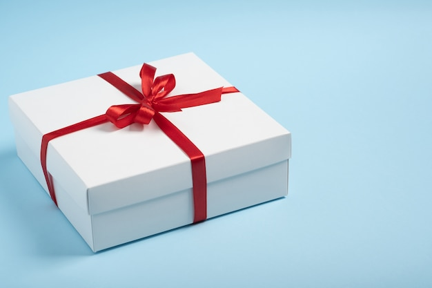 Luxury white gift box with red ribbon. christmas, new year, valintine day