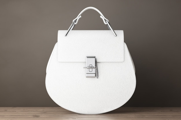 木製のテーブルの上の豪華な白い革の女性のバッグ。 3dレンダリング