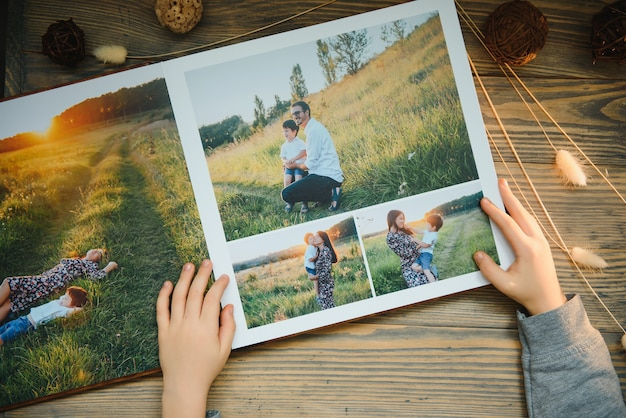 Luxury wooden photo book on natural background. family memories photobook. save your summer vacation memories.