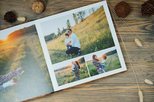 Роскошная деревянная фотокнига на натуральной поверхности. фотокнига семейных воспоминаний.