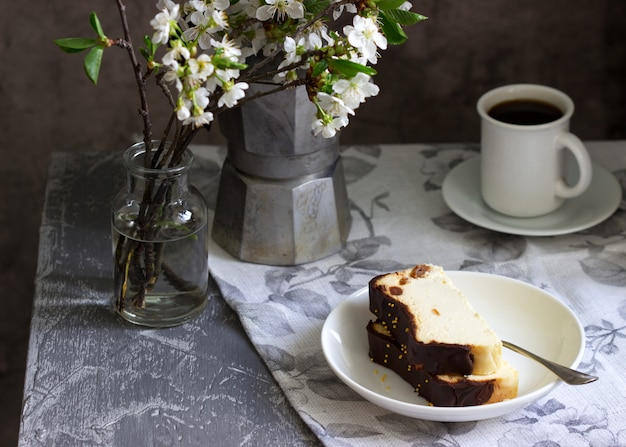 Lviv cheesecake, a traditional ukrainian dessert with raisins, coated with chocolate icing.