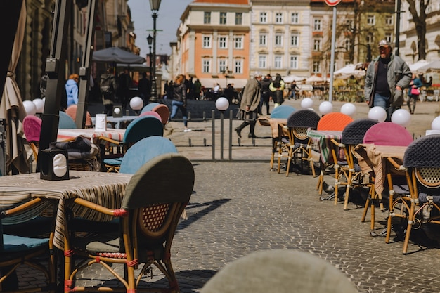 Lviv, ukraine - april 28, 2021: outside cafe tables in the city center copy space