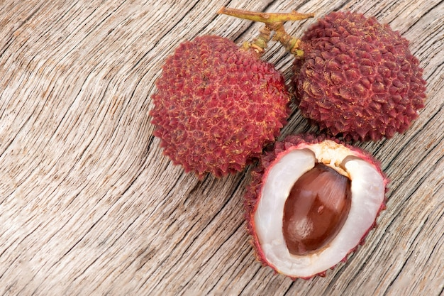 Lychee or litchi chinensis,fruits on an old wood .