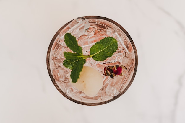 Lychee pink rose italian soda in glass decorated with mint leaves
