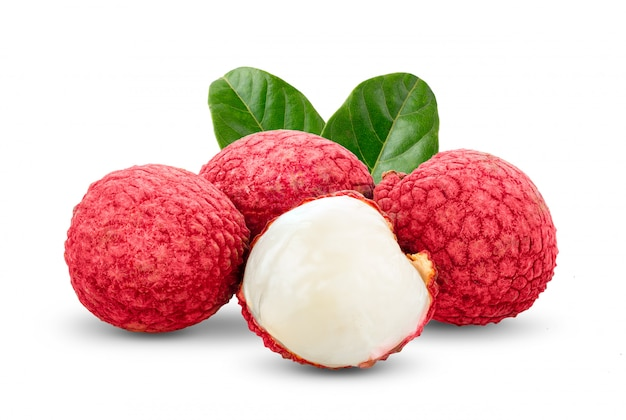 Lychee with leaves on white wall.