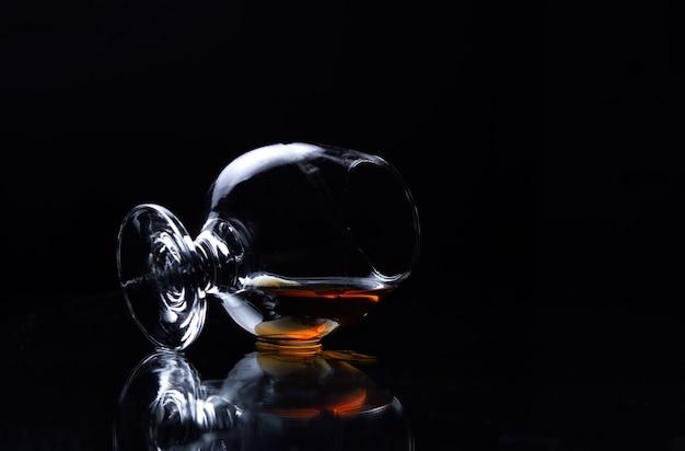 Lying cognac glass with cognac