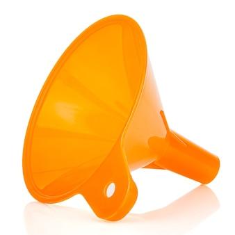 Lying orange plastic funnel isolated on white background
