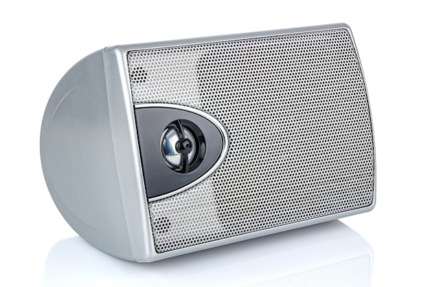 Lying small silver computer speaker isolated on white background