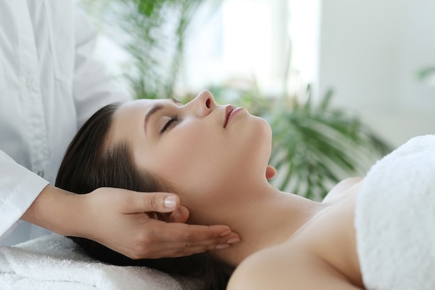 Lying woman receiving a massage. craniosacral therapy