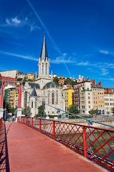 Lyon city with famous red footbridge on saone river