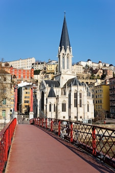 Lyon with famous red footbridge on saone river and church