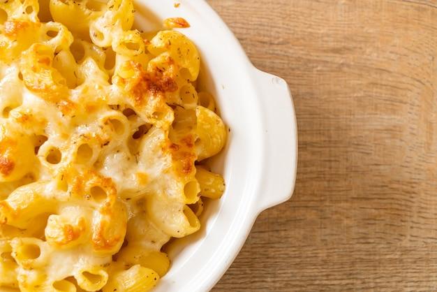 Mac and cheese, macaroni pasta in cheesy sauce - american style