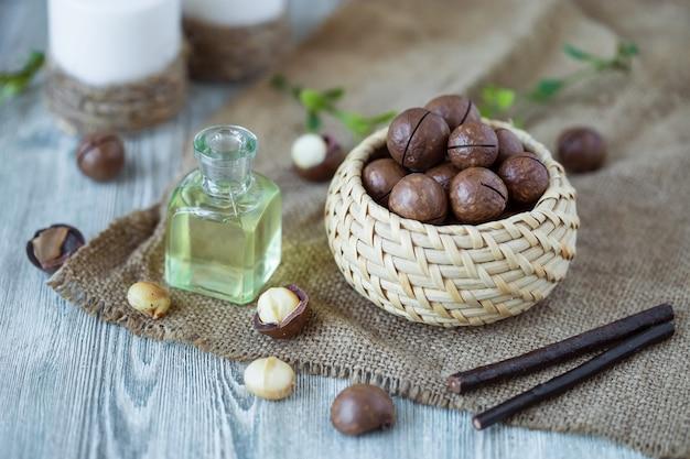 Macadamia kernels, walnut oil, on wood