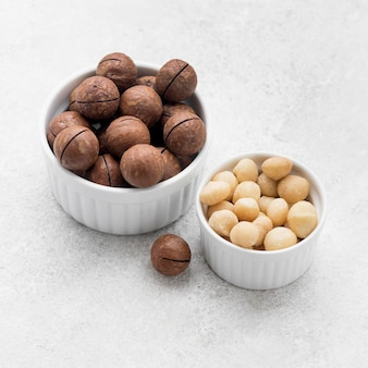 Macadamia nuts and chocolate in bowls