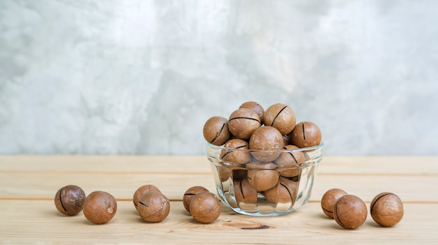 Macadamia nuts on a wooden table.