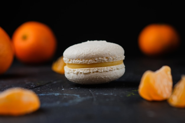 Macaron cake with tangerine filling. delicious and beautiful french dessert.