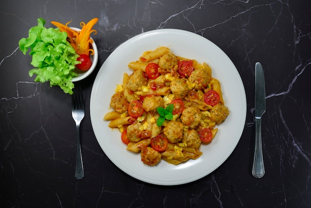 Macaroni chicken meatballs in marinara sauce with cheese italian food style