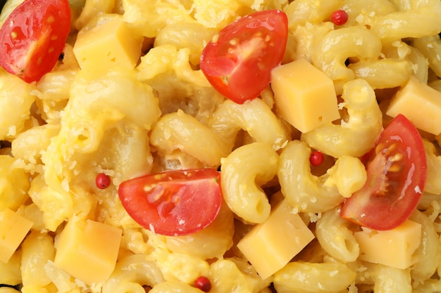 Macaroni with cheese all over background, close up