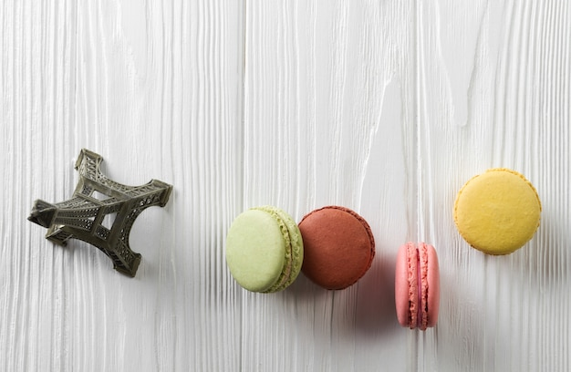 Macarons cakes on white wooden table