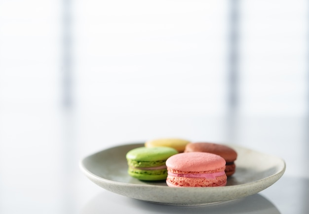 Macarons in a plate on the kitchen table