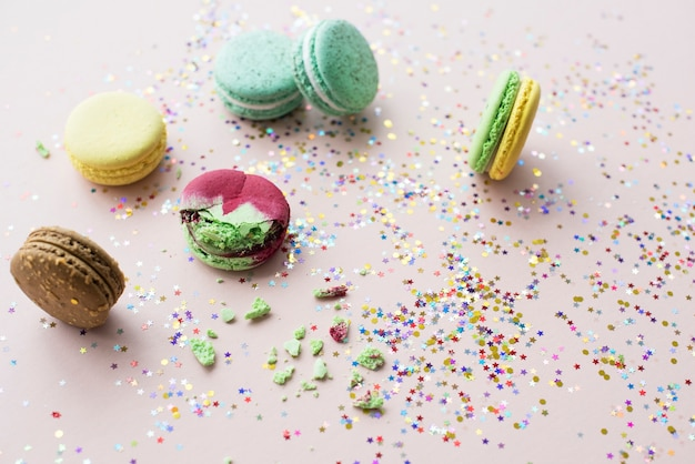 Macaroon decoration by confetti isolated on background
