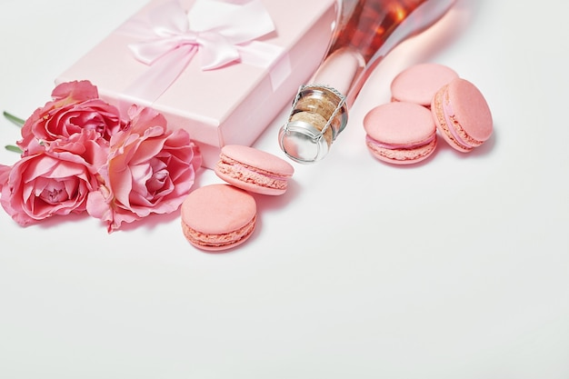 Macaroon sweets and bottle of champagne