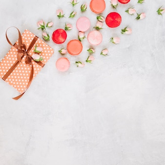 Macaroons and flowers near present