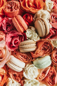 Macaroons on a background of flowers