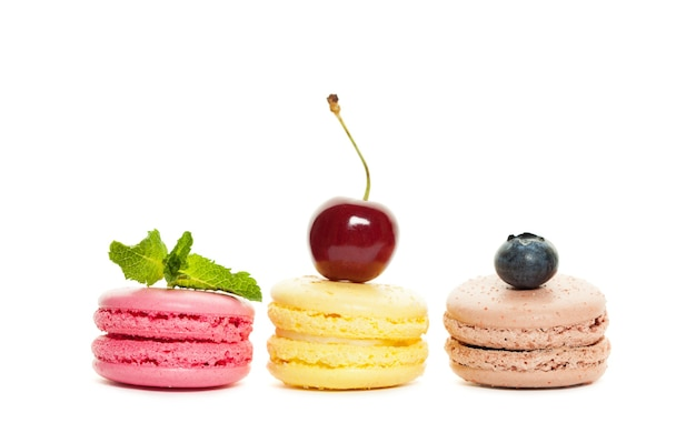 Macaroons and berry on white background