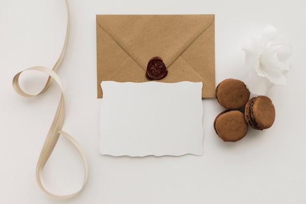 Macaroons beside wedding invitation card