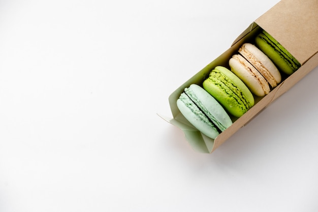 Macaroons in craft paper box