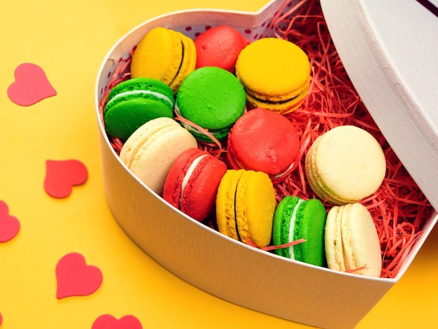 Macaroons in a gift box. heart-shaped box. copy space.