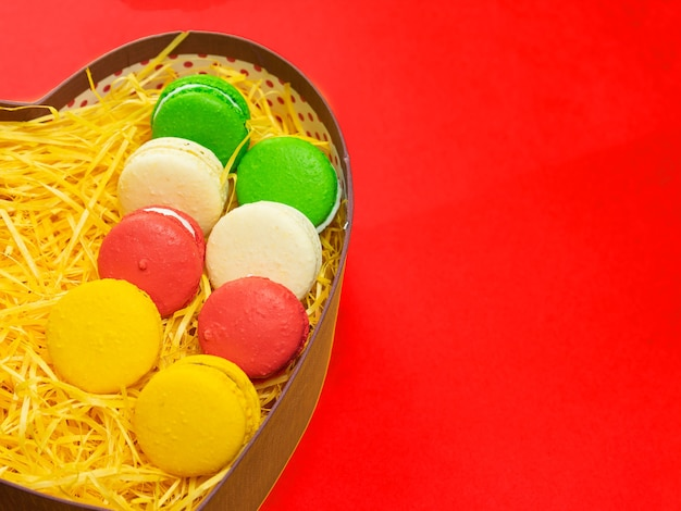Macaroons in a gift box. heart-shaped box