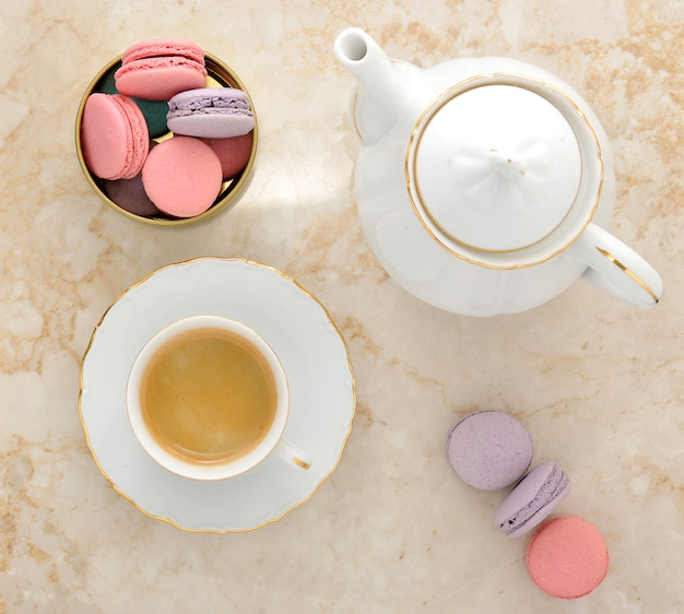 Macaroons on marble and coffee