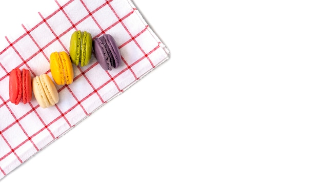 Macaroons on red and white cloth