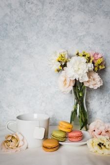 Macaroons surrounded by flowers