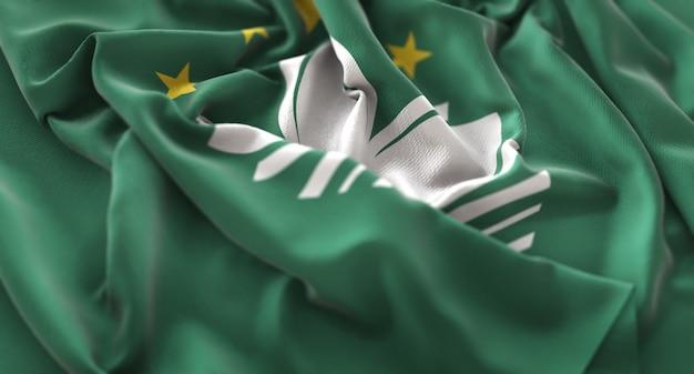 Macau flag ruffled beautifully waving macro close-up shot
