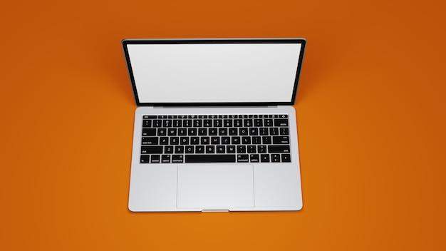 Изолировать вид сверху macbook на оранжевом фоне премиум фото