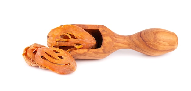 Mace in a wooden scoop, isolated on white background. nutmeg flower, myristica fragrans. natural spice, asian seasoning.