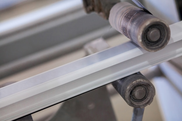 The machine glues the ribbon with the print on the profile production of pvc profile