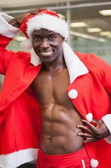 Macho man in santa costume at the gym