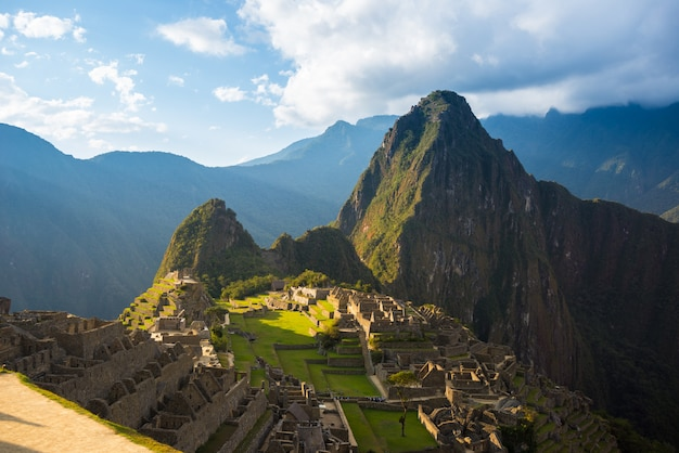 Machu picchu on the mountain ridge view from above sunset light