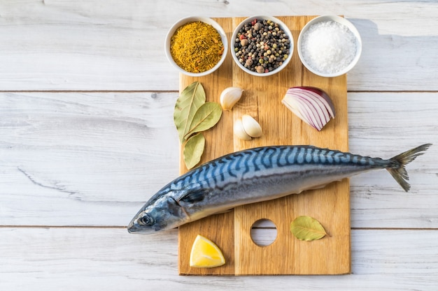 Mackerel cooking set. frash raw fish with spices.