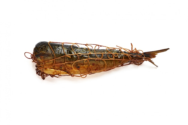 Mackerel hot smoked in spices, threaded thread isolated