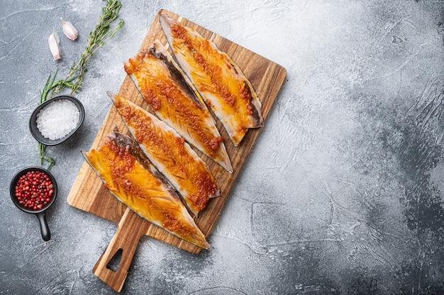 Mackerel marinated with paprika and saffron on grey background