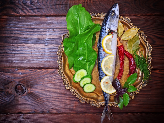 Mackerel with spices and herbs on copper plate